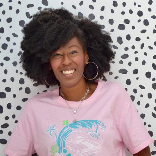 Toyin Laketu profile picture posing on spotty wallpaper